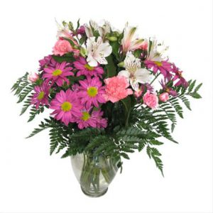 Colourful flower bouquet with Purple daisies and pink carnations by Brant Florist