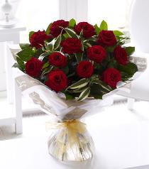 Photo of 12 Long Stem Grand Prix Roses Hand Tied - 500546