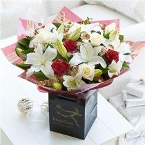 Photo of Christmas Rose & Lily Hand-tied No Vase  - 500304