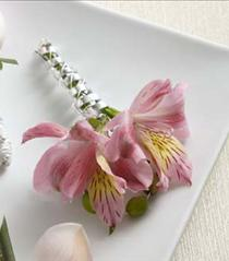 Photo of The FTD Pink Peruvian Lily Boutonniere - D12-4663