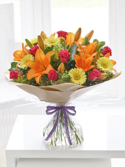Photo of flowers: LARGE SUNSHINE HAND-TIED