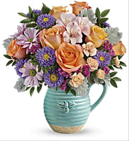 Photo of flowers: Teleflora's Busy Bee Pitcher Bouquet