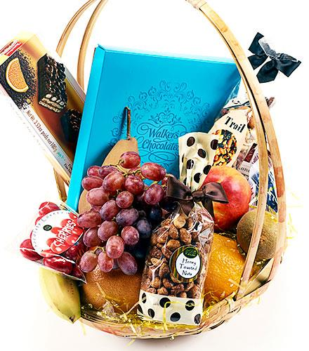 Photo of flowers: Fruit, Chocolates & Snacks Gift Basket