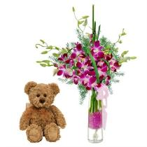 Photo of Orchids in Vase with Teddy  Bear - IC1505