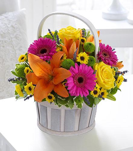 Photo of flowers: Vibrant Basket Arrangement