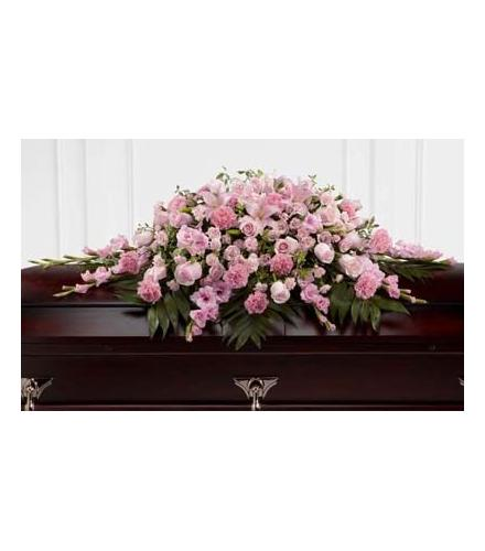Photo of flowers: The Sweetly Rest Casket Spray