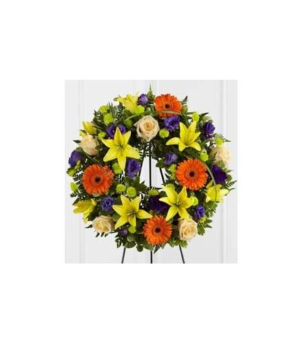 Photo of flowers: Radiant Remembrance Wreath on Easel